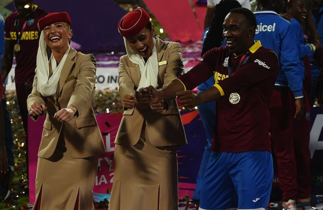 Dwayne Bravo, described by Mark Nicholas as the craftiest bowler in the tournament, demonstrating the 'champion' dance to these air hostesses.