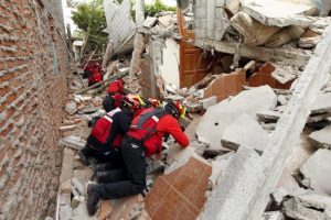 Firemen working after an earthquake struck off Ecuador's Pacific coast, at Tarqui neighbourhood in Manta.