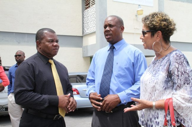 From left, Major Errol Brathwaite, principal of Ellerslie Secondary School, President of the Barbados Union of Teachers Pedro Shepherd and head of the Barbados Secondary Teachers' Union Mary Redman in discussion.