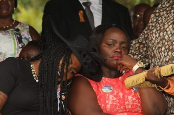 Daughter Latoya (right) was overcome by grief.
