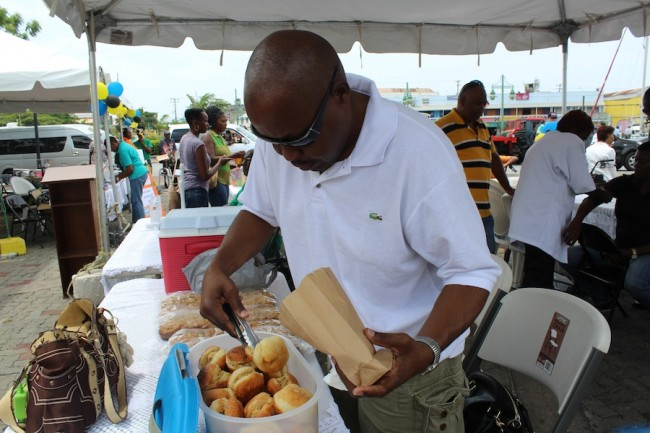 Paul Bayne serving his muffin and saltfish.