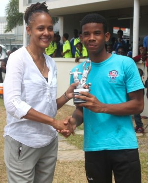 Jai Shorey of Pro-Shottas won the best goalkeeper award in the under-15 division of the Barbados Cup Football competition. Here he collects his award from St Michael South East MP Santia Bradshaw.