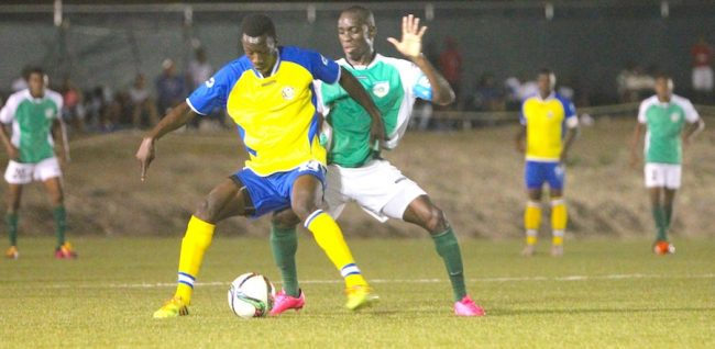 Roy Richards defends well for Rendezvous against Barbados Defence Force Sports Programme's captain Romario Harewood. (Pictures by Morissa Lindsay)