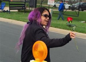 Tyka Nelson holds a rose outside Paisley Park, the home of her brother Prince in Chanhassen, Minnesota, on Thursday, April 21.