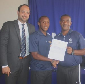(From left) Jonathan Martinez of CONCACAF looks on while Renaldo Gilkes, the new chairman of the BFA Youth Committee, receives his certificate of recognition from CONCACAF Instructor Lenny Lake.