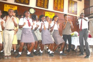 "West Indies Twenty20 World Cup winner Hayley Matthews (second right) having a ball with members of her alma mater doing Dwayne Bravo's  ""Champion"" song and dance."