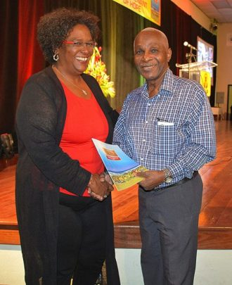 Opposition Leader Mia Mottley (left) presents a copy of the Covenant to former speaker of Parliament Lindsay Holder.