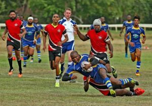 Barbados' Troy Grant (ball in hand) is tackled by his Trinidadian opponent. (Pictures by Peter Marshall)