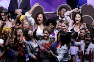 Brazil's President Dilma Rousseff (centre) greets supporters during the opening ceremony of the National Policy Conference for Women in Brasilia, Brazil on Tuesday.