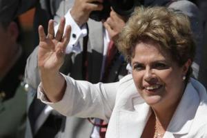 Brazil's President Dilma Rousseff greets supporters as she leaves Planalto president palace in Brasilia, Brazil on Thursday.