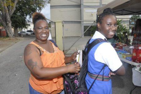 Kerri Ann Lewis making sure her daughter Kaela Lewis has all the necessary tools in her bag.