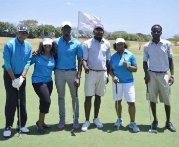 Beaumont Banfield (BB Insurances), Kaymar Jordan (CEO of Barbados TODAY), Anderson King (VP at Sagicor) and Wanda Mayers of Sagicor General (second from right) share a photo on the course with golf caddies.