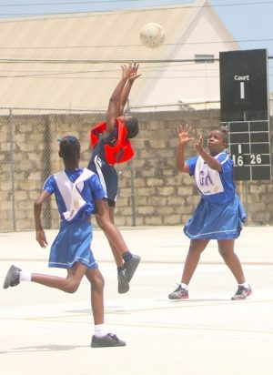 Deacons Primary's goal-defender Shanya Agard goes aerial in an effort to reach the ball that went to Greoge Lamming goal-attack Dominique Blenman.