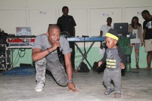 Damian Marvay performing with one of his youngest fans.