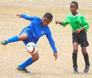 St Bartholomew's goal-scorer Raneco Browne showed great control to keep the ball down and away from from Donte Price of St Christopher Primary. (Pictures by Morissa Lindsay)