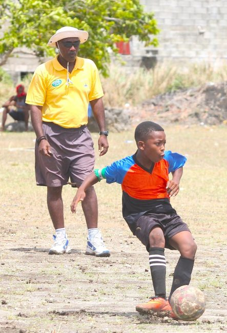 Wilkie Cumberbatch's captain Demari Stoute scored a penalty under the watchful eyes of National Sports Council coach Frederick Bynoe.