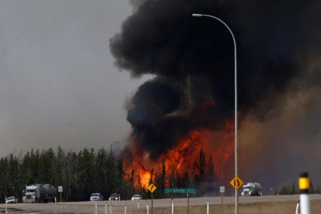 A wildfire burns near Highway 63 south of Fort McMurray, Alberta, May 6, 2016. REUTERS/Chris Wattie