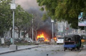 A general view shows the scene of a suicide car bombing outside Hotel Ambassador on Maka Al Mukaram Road in Somalia's capital Mogadishu on Wednesday.