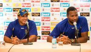 Barbados Tridents' Robin Singh (left) and Kieron Pollard.