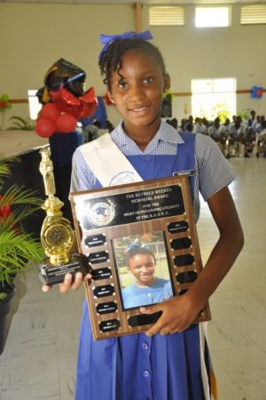 Wangari Dotton received the prizes for the Most Outstanding Student in the 11-Plus Examination at Reynold Weekes Primary School.