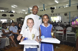 Top Boy Zachary Gill and Top Girl Kandi Douglas with Archdeacon Eric Lynch.