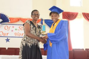 Jasmine Ferdinand receiving the trophy for Best Female Student in the Barbados Secondary Entrance Examination.