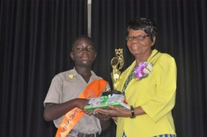 Sherwin Bourne Jr receiving the prize for Most Outstanding Male in mathematics and English.