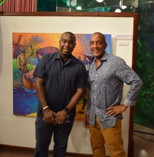 Barbados Museum  & Historical Society deputy director Kevin Farmer and artist Omowale Stewart.