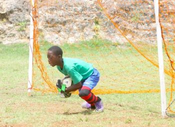 Deacons Primary's custodian Shane Carrington was the hero when he made a good save to deny Ignatius Byer Primary in the penalty shoot-out.