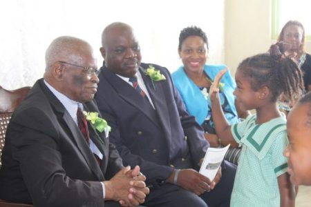 Five-year-old Raniyah Bailey showing the Governor General  how old she is.