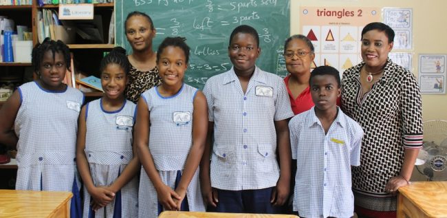 From left are students Daija Walker, Tamika Brin, Kaya Hinds, Rashidi Boyce and Ajani Lovell. In the background are class teacher Margaret Stewart (in red) and principals Deborah Rouse (left) and Sandra Watson (right).