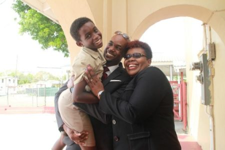 Jayden Greenidge's parents were overjoyed to hear that their nine-year-old son, who sat the Common Entrance Examination two years early, will be heading to Harrison College. Here, dad Corey lifts Jayden, as mum Richelle joins in celebrating his exam results.