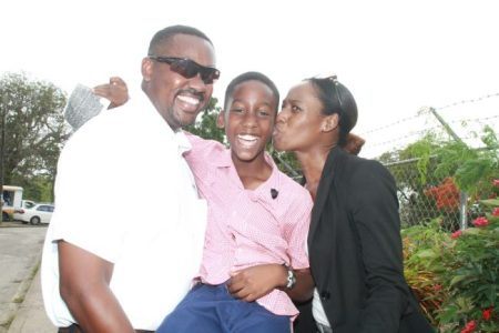 Khalil Vanderpool celebrating with his parents Dwayne (left) and Tricia (right) after he received his results.