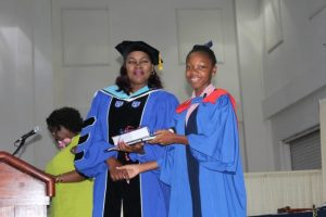 Azaria Johnson receiving the Principal's Prize For Academic Performance from Dr Monica Watson.