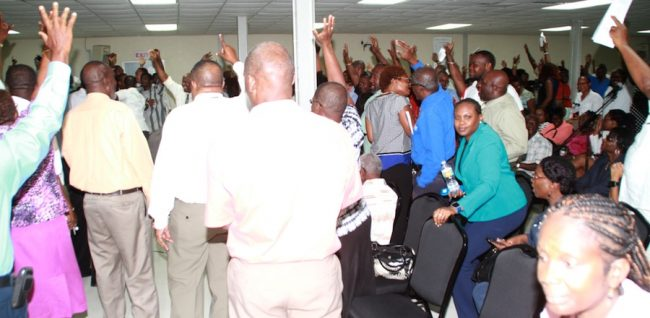 Here, NUPW members raise their hands in support of the embattled President Akanni McDowall.