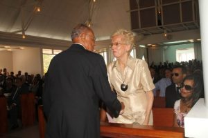 Acting Governor General Sir Philip Greaves greeting Dr Oscar Jordan's widow Marsha.