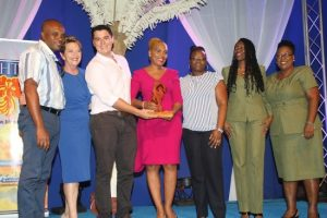 General manager of Atlantis Submarines Barbados, Roseanne Myers (at centre),  and her team collecting the Business Excellence Award from CEO of the BHTA,  Sue Springer (second from left), and general manager of Sugar Bay Hotel, Morgan Seale (third from left).