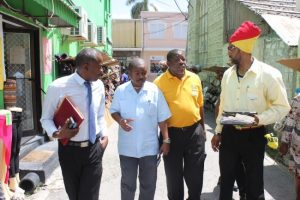 Officials touring sections of The City today, including (from left) Manager of Markets in the Ministry of Agriculture Sherlock King; Acting Senior Superintendent of Markets Gregory Payne and President of the BARVEN Alister Alexander.