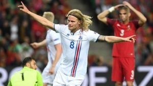 Iceland's midfielder Birkir Bjarnason celebrates the team's first goal.