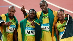 Jamaica's relay team at 2008 Olympics (left to right) Asafa Powell, Nesta Carter, Usain Bolt and Michael Frater.