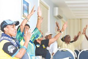 Supporters of the Save Our Bahamas campaign cheer at the Grace Community Church hall as results come in for New Providence late last night, confirming that voters overwhelmingly rejected the proposed ammendments to the constitution.
