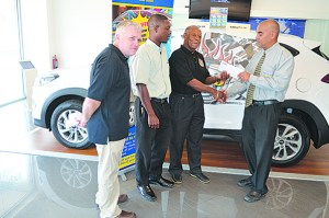 Mark Wilson (right) hands over the sponsor's cheque to BADD treasurer Elridge Grant, while BADD's chairman Jason Downey (left) and Steven Rawlins of Courtesy Car Rentals look on.