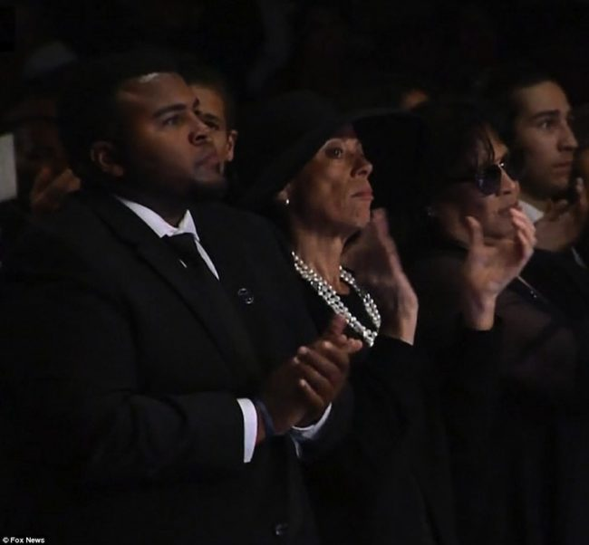 Muhammad Ali's youngest son Asaad Ali (l) stands beside his mother and the legendary boxer's fourth wife, Lonnie Ali, at today's service.