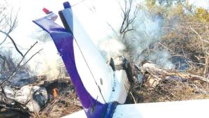 The remains of an aircraft that crashed in bushes near the runway at the South Bimini Airport on Sunday.