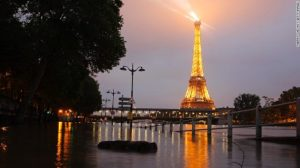 The river Seine overflows its banks next to the Eiffel Tower in Paris on Thursday.