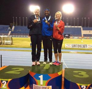 Akela Jones (centre) showing off her gold medal. (GP)