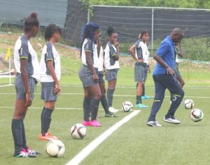 Barbadian coach Richard Forde doing a demonstration during the Barbados Football Association's Elite Summer Camp. (Pictures by Morissa Lindsay)
