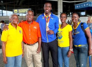 Barbados' lone medallist in Poland Mario Burke celebrates with family including (from left) grandmother Pauline Clarke, father Vincent Burke, mother Marvo Burke and aunt Marcia Burke. (Pictures by Morissa Lindsay)
