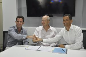 Developers Mark Maloney (right) and James Edgehill (left) shaking hands after the agreement was signed with Vice President of Hyatt Pat McCudden.