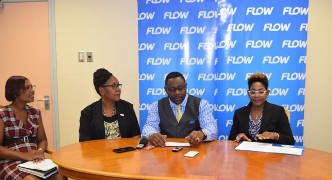 From left, Programme Coordinator Bridgette Marshall-Griffith, Chief Community Development Officer Patricia Hackett-Codrington, Minister of Social Care, Constituency  Empowerment and Community Development Steve Blackett and Flow Barbados' Director of Corporate Communications & Stakeholder Management, Marilyn Sealy.